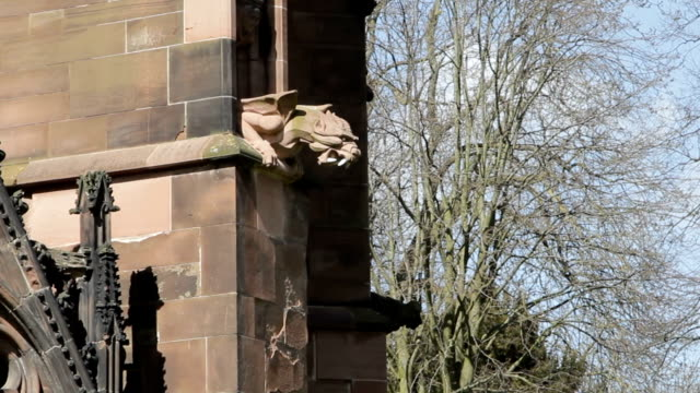 Ugly Gothic Gargoyle Dragon looms from Lichfield Cathedral video