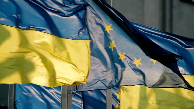 Ukrainian flag and flag of the European Union are fluttering in the wind video
