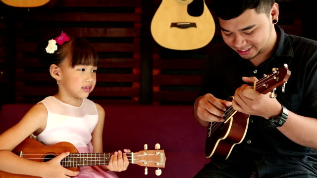 Ukulele Guitar teacher teach music video