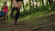 Ultra marathon runner running outdoors in the woods video