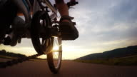 4K Ultra UHDTV 3840X2160 :  Little boy goes on bicycle forward sunrise by the asphalt road video