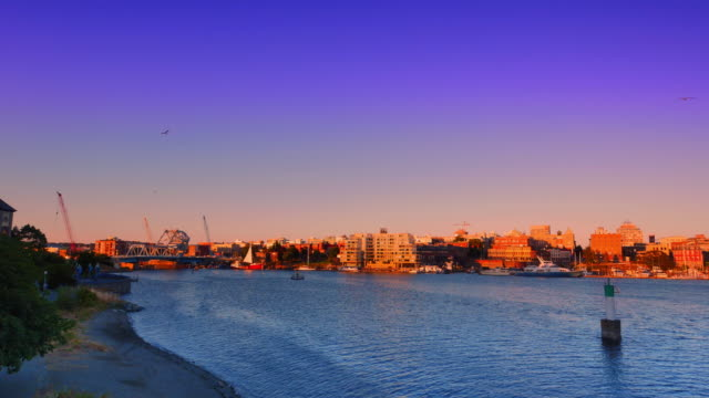 Ultra Wide Pan Shot of the City of Victoria BC Inner Harbour, Summer Sunset video