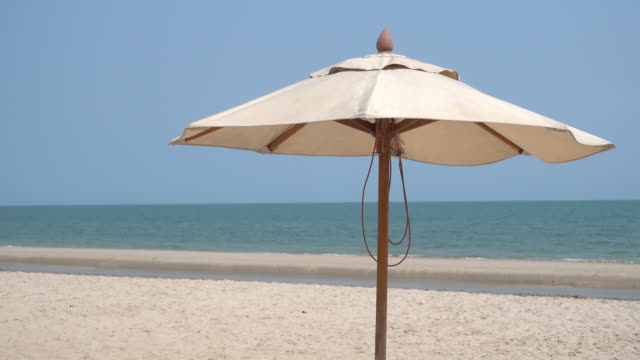 Umbrella on the beach and sea video