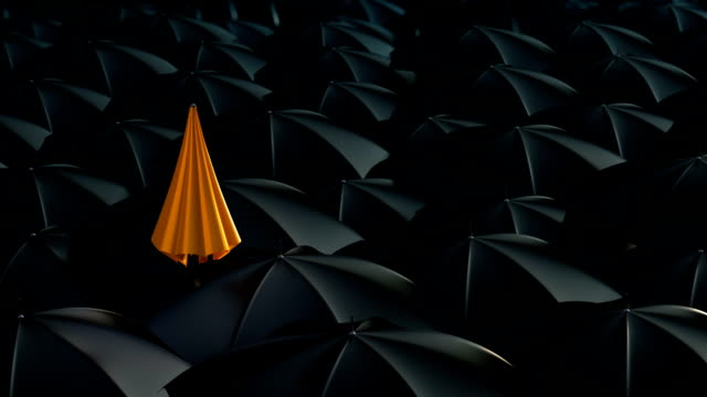Umbrella standing out from crowd mass concept video