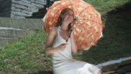 HD CRANE: Umbrella twirling on the ledge video