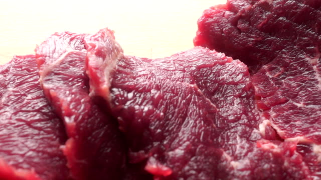 Uncooked beef close up dolly shot video