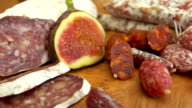 uncooked jerked sausages, baguette and figs video