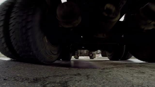 Under truck trailer ride over camera video