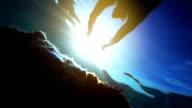Underwater footage of man snorkeling in sea towards the sun video