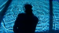 Underwater Shadow Of Man And Waves On Swimming Pool video