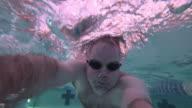Underwater swimming in indoor pool video