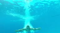 Underwater View Of Man Diving Into Swimming Pool video