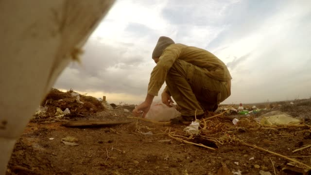 unemployed dump homeless dirty man looking food waste in a landfill social  video video