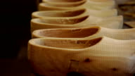 Unfinished clogs on a workbench video
