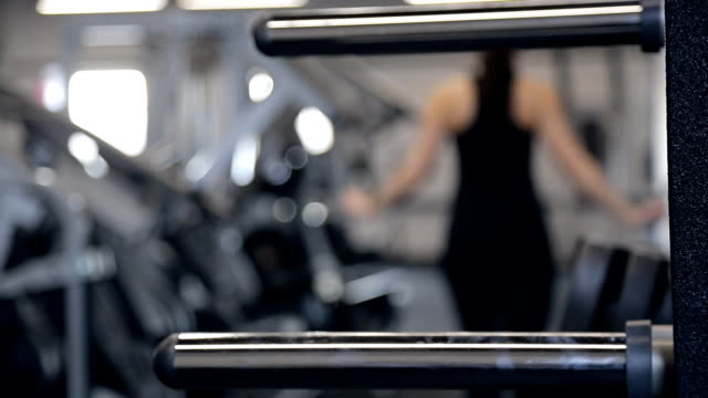 Unfocused shooting woman going out in fitness studio video