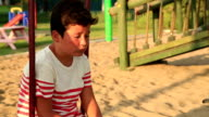 Unhappy child at the playground video