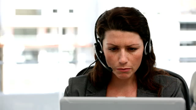 Unhappy woman talking on the headphone video