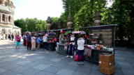 Unidentified tourists walk by souvenirs stalls opposite Church of the Saviour on Spilled Blood video