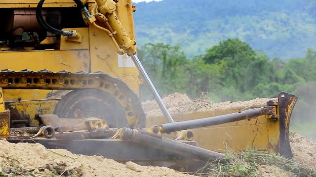 Unidentified worker control Bulldozer to excavator video