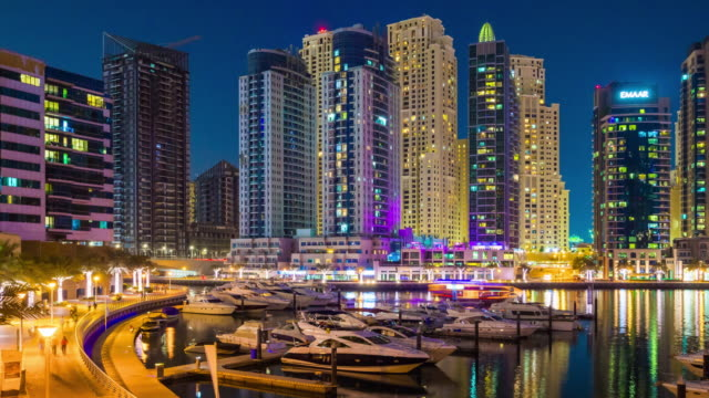united arab emirates dubai marina night light yacht dock famous panorama 4k time lapse video