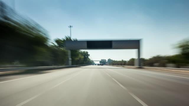 united arab emirates dubai to abu dhabi sunny day road trip front panorama 4k time lapse uae video