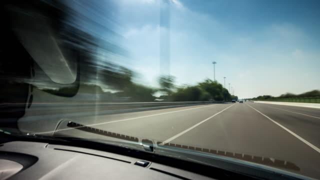 united arab emirates sun light dubai to abu dhabi road trip front window panorama 4k time lapse uae video