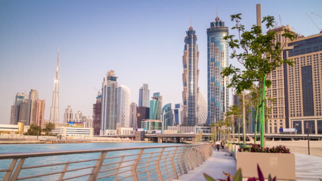 united arab emirates sunset day light dubai new canal walk downtown panorama 4k time lapse uae video