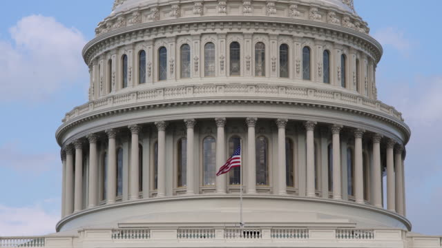 United States Capitol Dome and American Flag - Close Up in 4k/UHD video