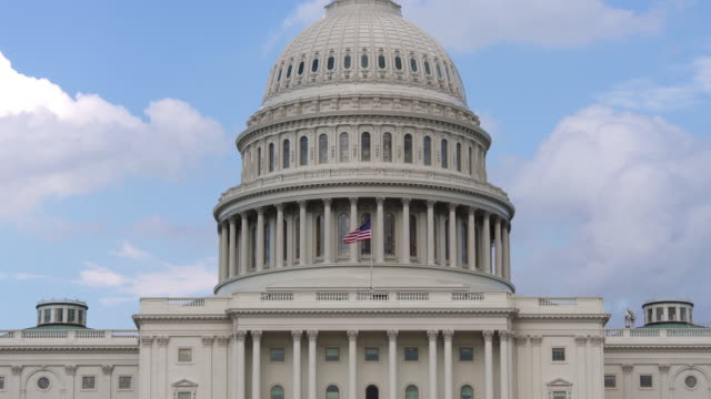 United States Capitol Dome and American Flag - Zoom In - 4k/UHD video
