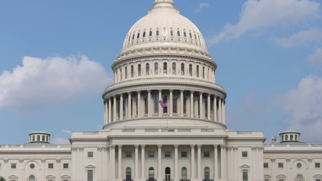 United States Capitol Dome and American Flag - Zoom Out in 4k/UHD video
