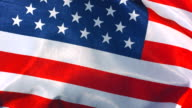 United States flag waving in wind, slow motion video