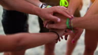 Unity oath pile of hands on the beach video