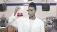 University Student studying in a science lab video