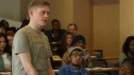 University student talks in seminar video