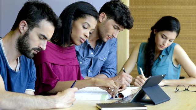 University students studying video
