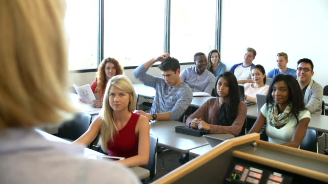University Students Using Digital Tablet And Laptop In Class video