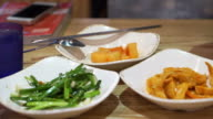 Unlimited refilling kimchi in Korean restaurant. Radish pickle is available on the table video