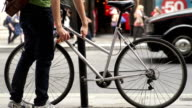 Unlocking a bicycle on a city street. video