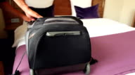 Unpack your baggage in a hotel video