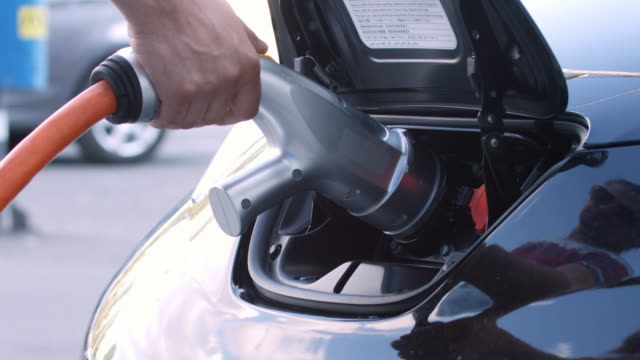 Unplug charging cord from e-car video