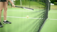 Unrecognizable Female Bouncing a Tennis Ball inside the Court video