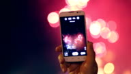 Unrecognizable hand with smartphone Filming and taking pictures of Fireworks Display. Beautiful Fireworks HD video