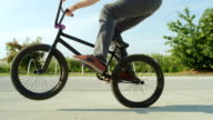 SLOW MOTION CLOSE UP: Unrecognizable man riding bmx bike and jumping bunny hop video