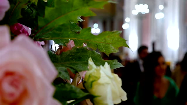 Unrecognizable people on a wedding ceremony in a church video