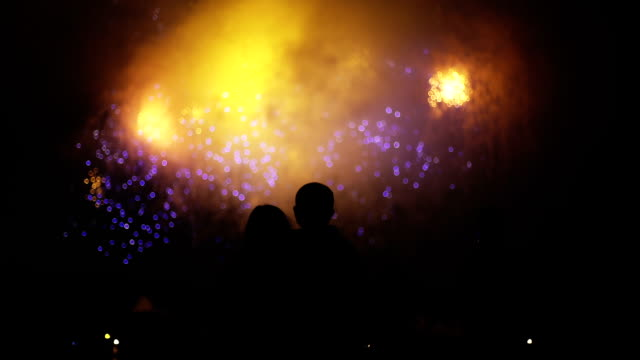 Unrecognizable people watching fireworks video
