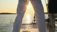 HD: Unrecognizable Person Sailing On The Catamaran At Sunset video