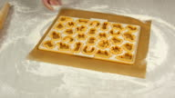 Unroll dough on cutting sheet. Making Christmas Gingerbread Cookies. video