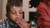 Untidy boy smeared in cake. video