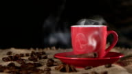 Сup of hot coffee spreads a pleasant fragrance in the room. Black background video