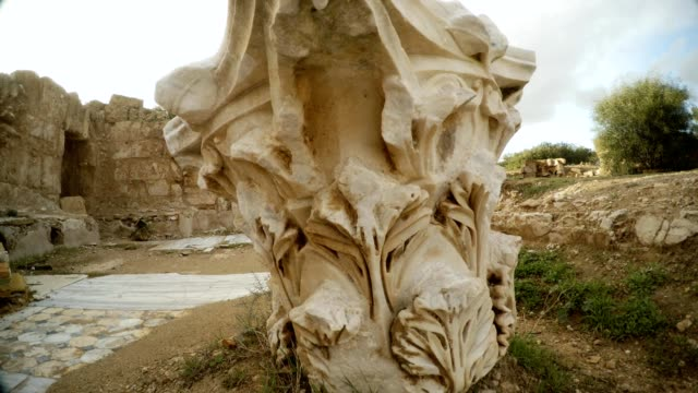 Upper part of antique column on ground Antique street Salamis Cyprus video
